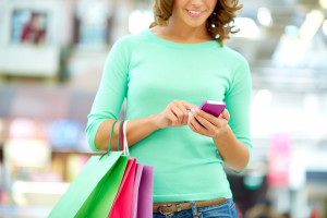 bigstock-Smiling-woman-doing-shopping-a-41874553